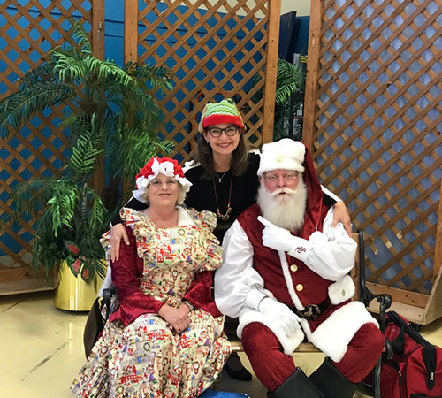 Ms. Rinaldo with Mr and Ms. Claus